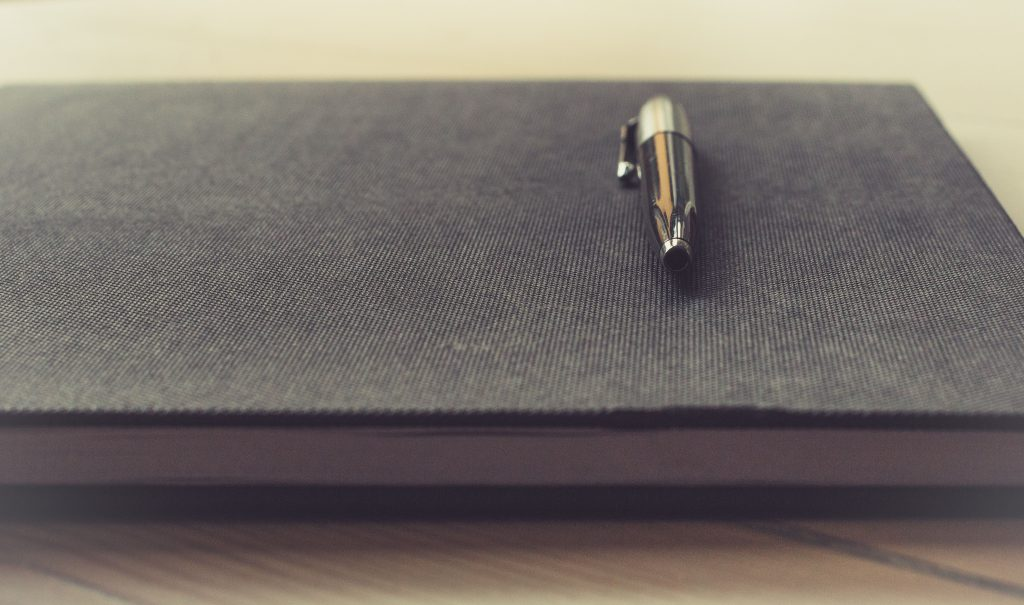 notebook and fountain pen